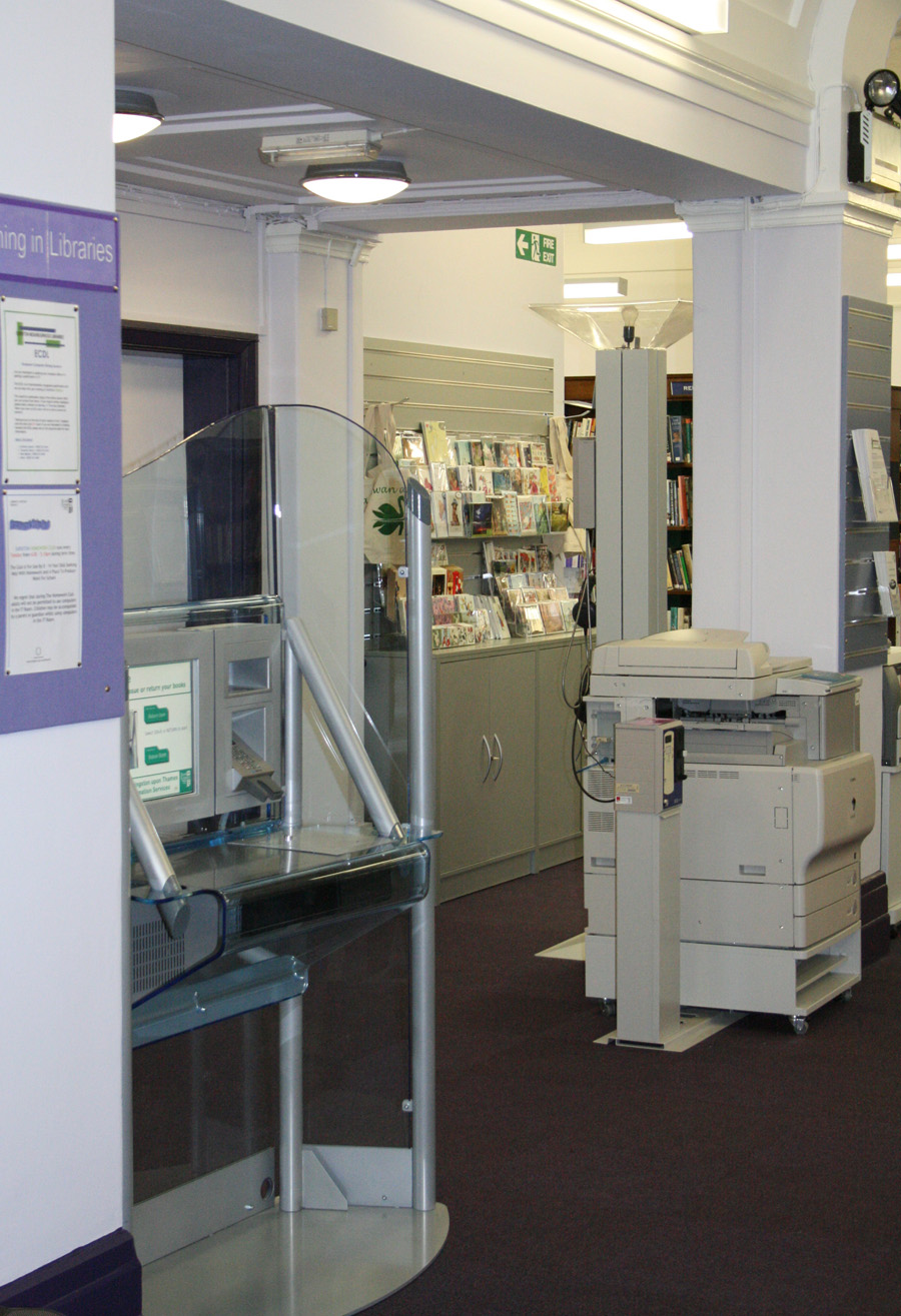 Self service arrives at the library. Staff are on hand to assist when  needed.